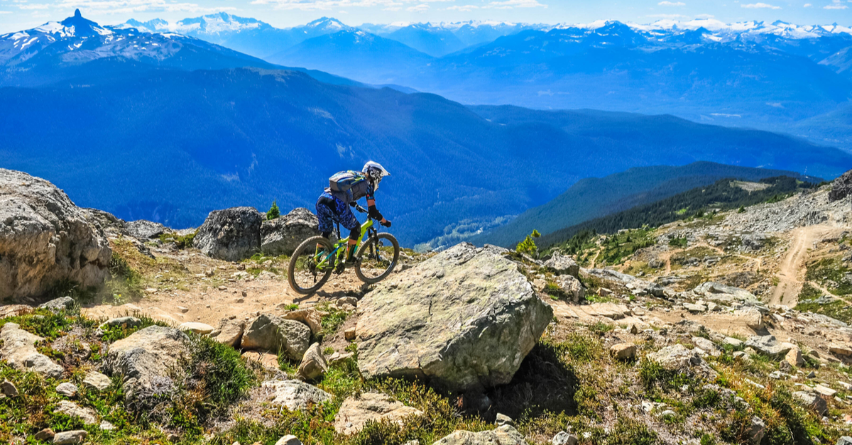 Mountain biker descending Whistler Mountain.