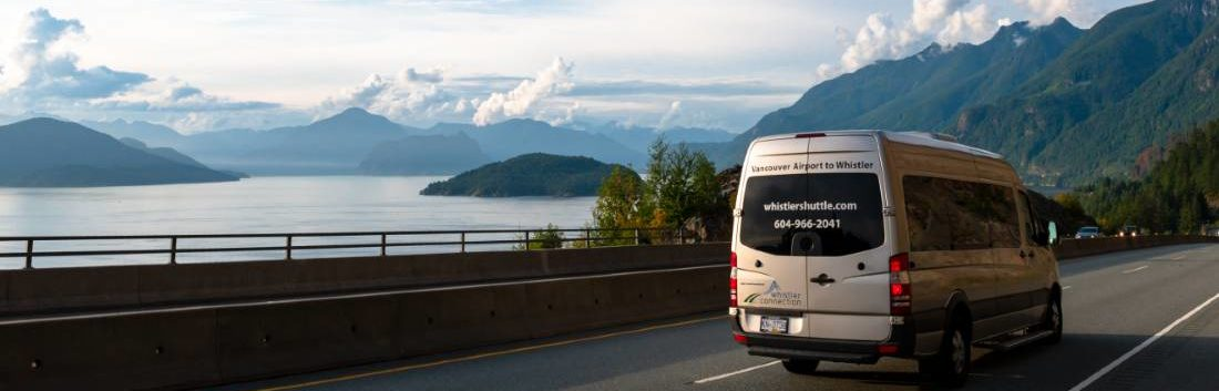 Whistler Shuttle Sprinter van driving to Whistler on the Sea to Sky highway